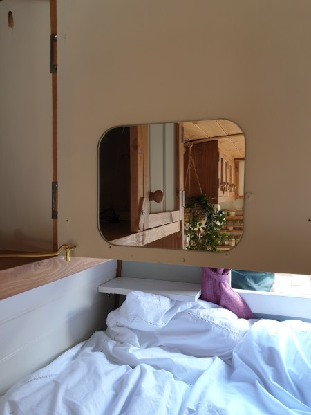 A wee mirror inside the cupboard for the fancier weekends...hidden if it's better not to know :-)