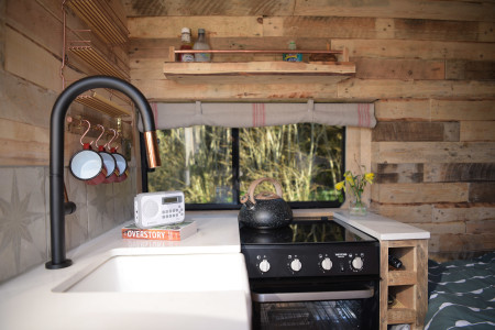 Kitchenette includes hob, oven, sink and fridge