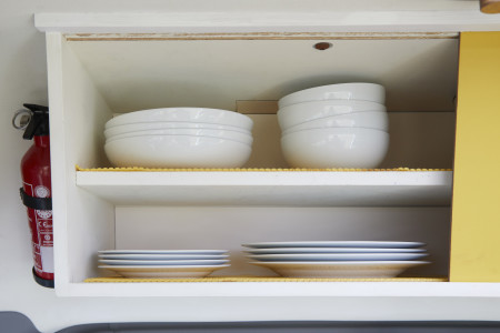 Kitchen cupboard with bowls and plates.