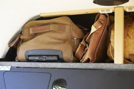 Detail Bag storage behind match box collection.
