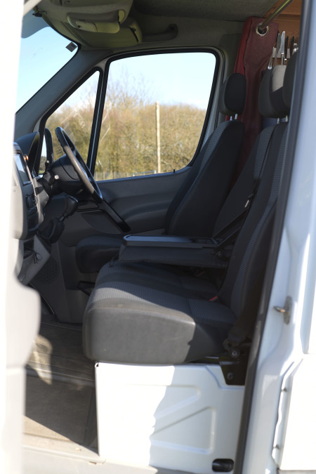 Inside the cab, a brilliant extra cup holder so you can keep hydrated while on the move!