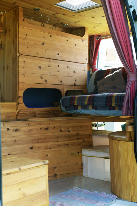The view in from the side door, look at all that fabulous storage and cosy sofa.