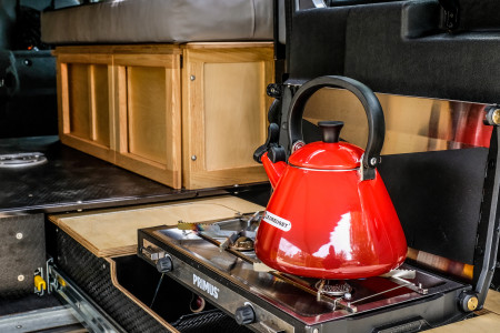Clever drawer stores stove and kitchen ware