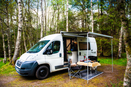 Exterior with awning and camping set up