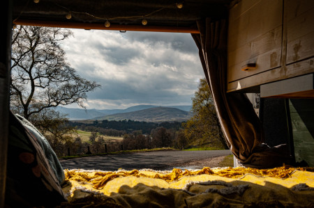 Bed with view of Glen Esk