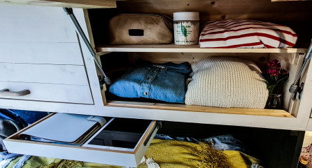 Storage above bed and small pull out shelf