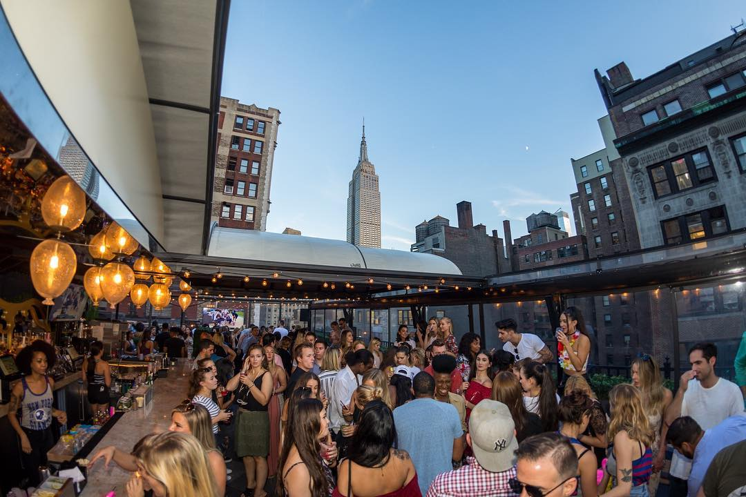 busy-rooftop-bar-with-a-view-of-new-york