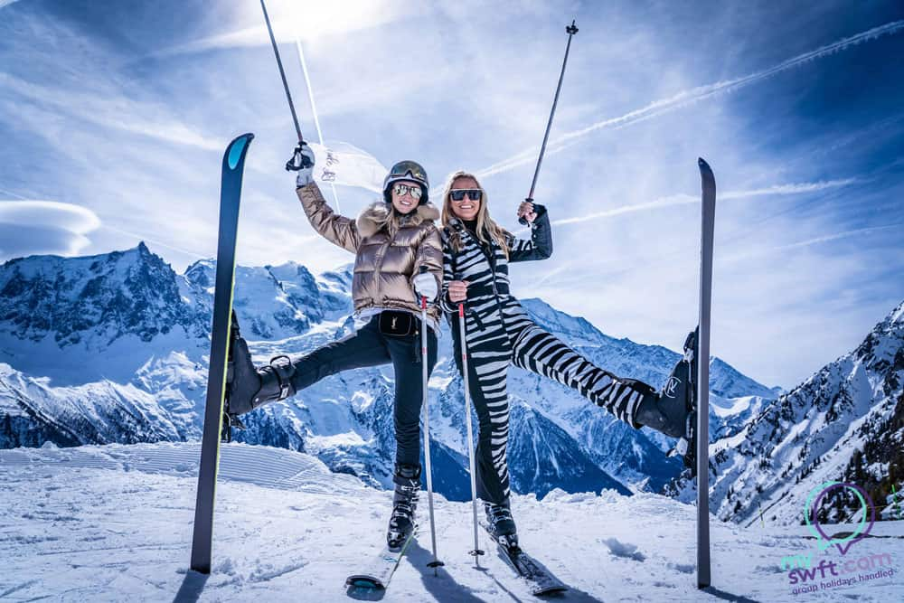 two-ladies-doing-a-ski-pose-in-the-sunshine