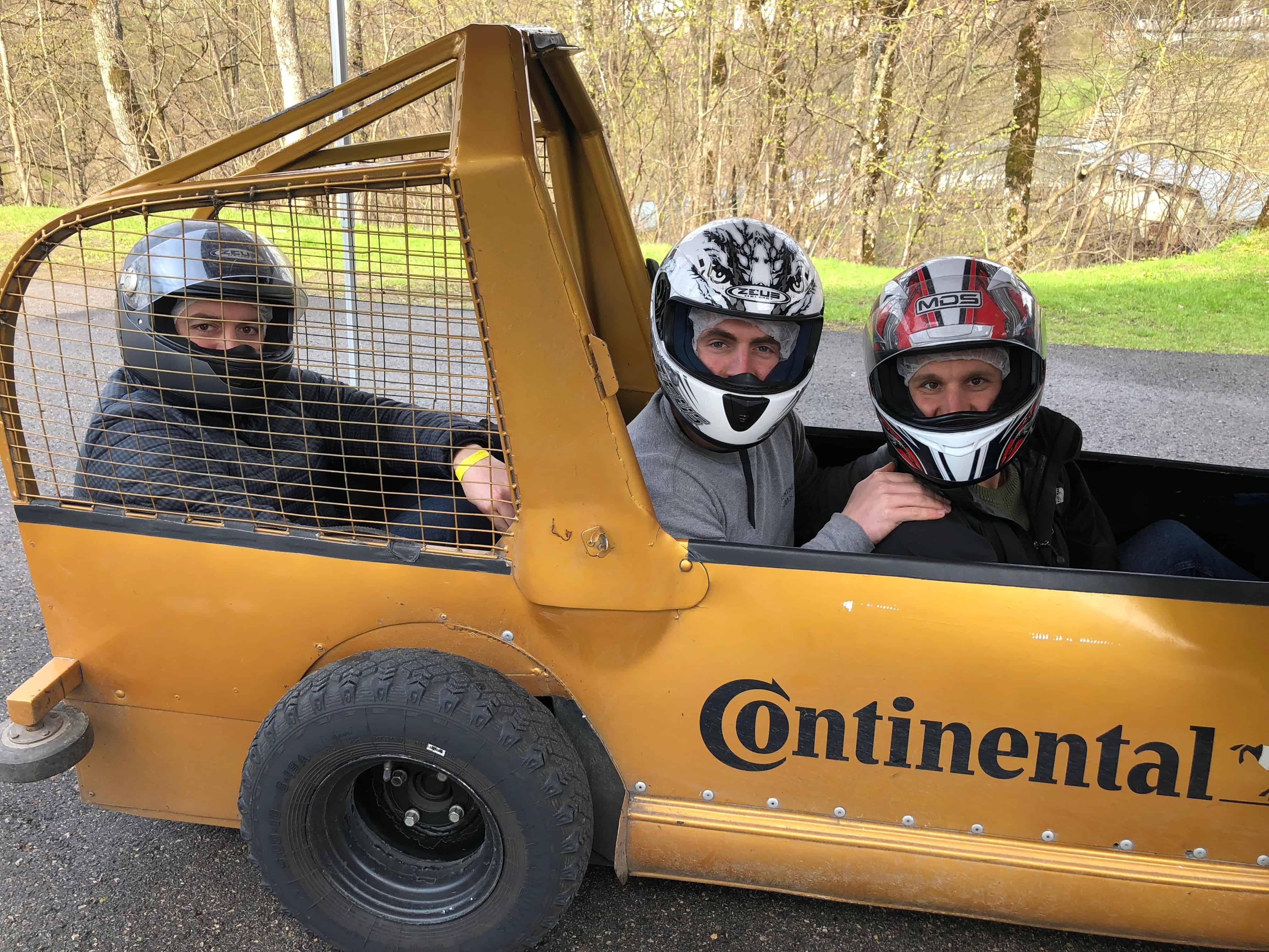 3-men-in-a-bobsleigh-on-wheels