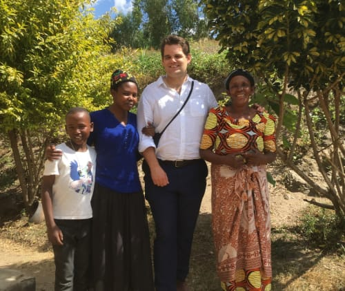 A picture of our Head of Coffee with coffee farmers in Rwanda