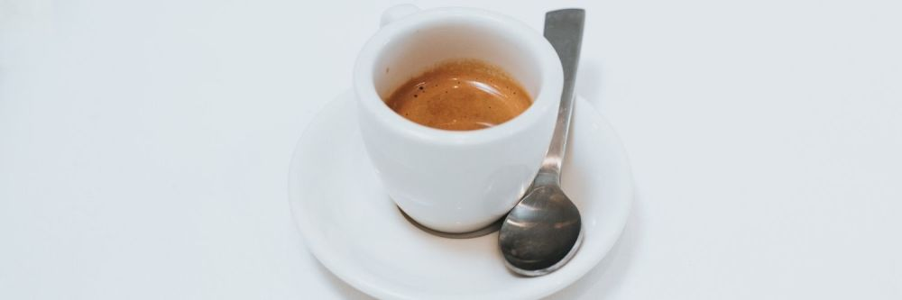An espresso in a cup and saucer