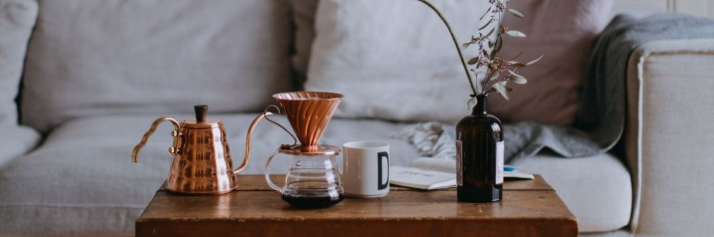 Delicate coffee set arranged on a coffee table