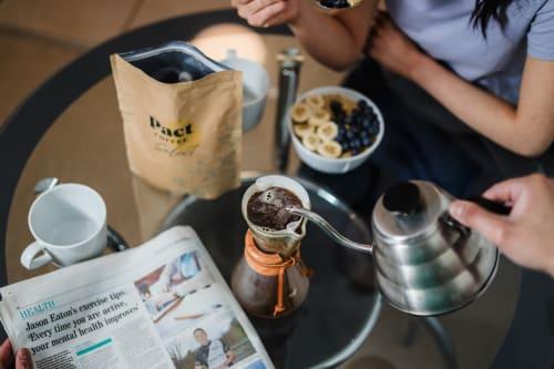 People brewing coffee at breakfast