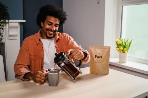 Man brewing filter coffee