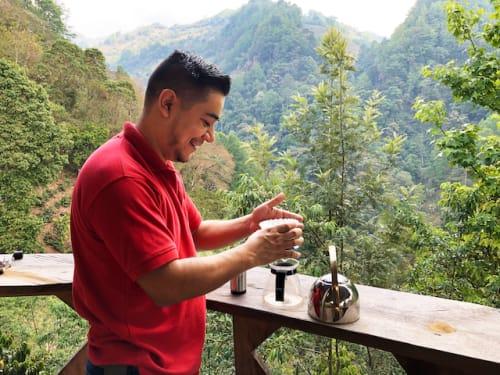 Coffee farmer brewing coffee