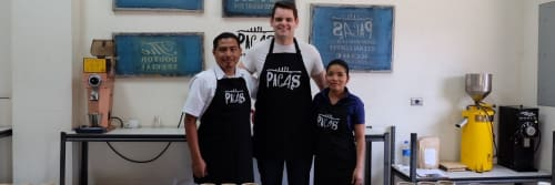3 workers from Cafe Pacas standing together and smiling