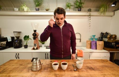 A man tasting coffees