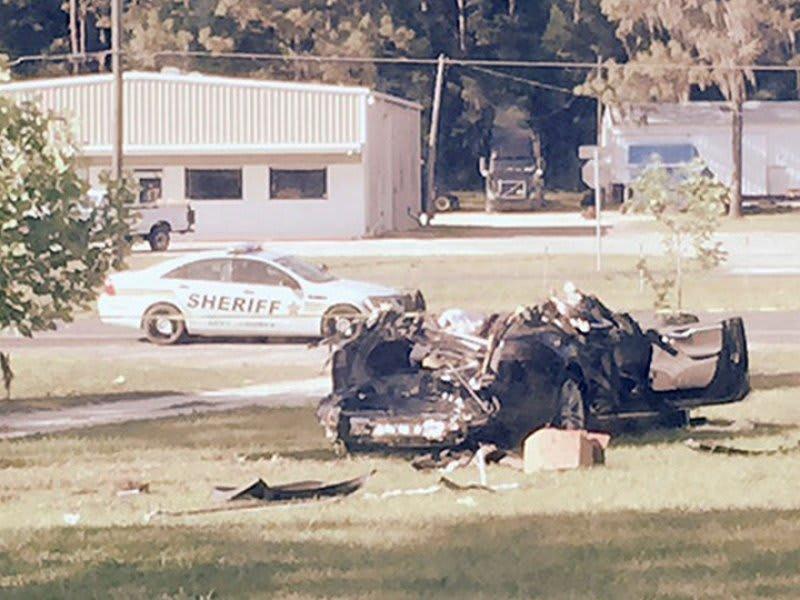 Tesla driver in fatal crash wasn't watching video, witness tells investigators