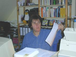 fppaper.jpg: She's checking her list...