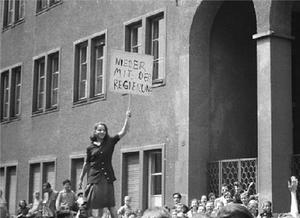 Documentary photo of girl holding sign in Leipzig, 17 June 1953