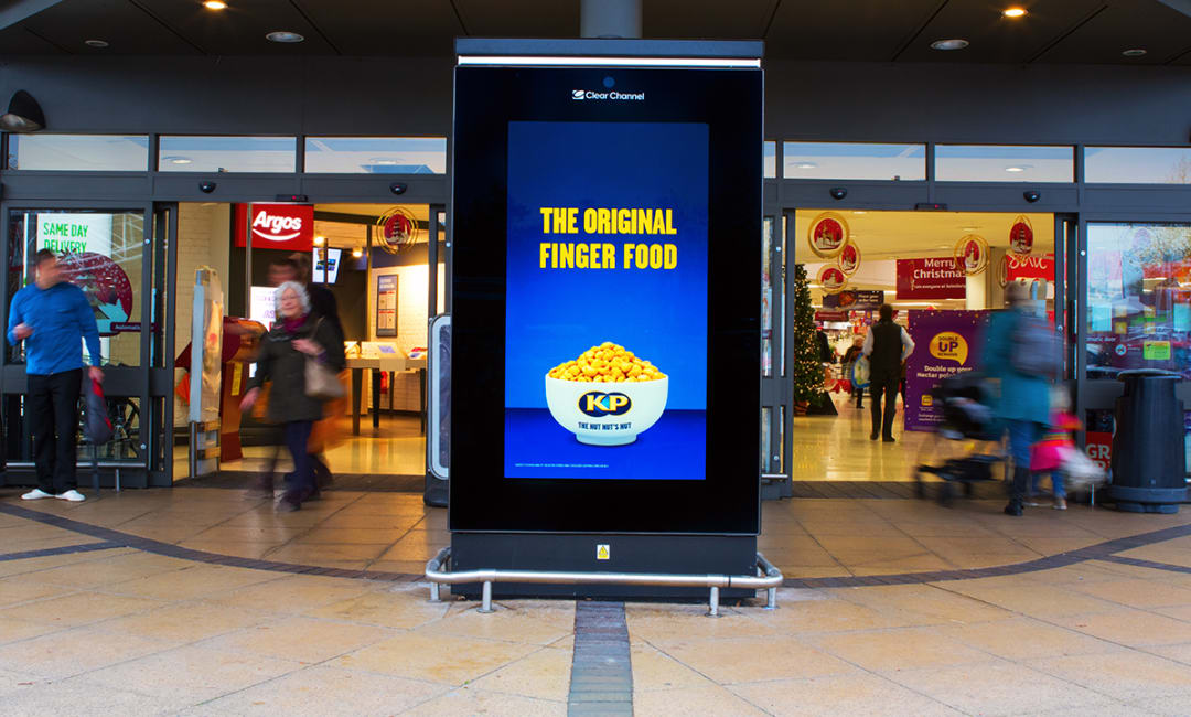 Digital advertising screen outside supermarket