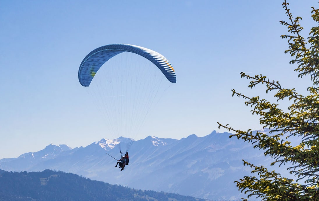 Paragliding above the Swiss Alps