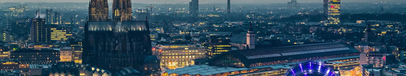 Waterside Cologne skyline at dusk