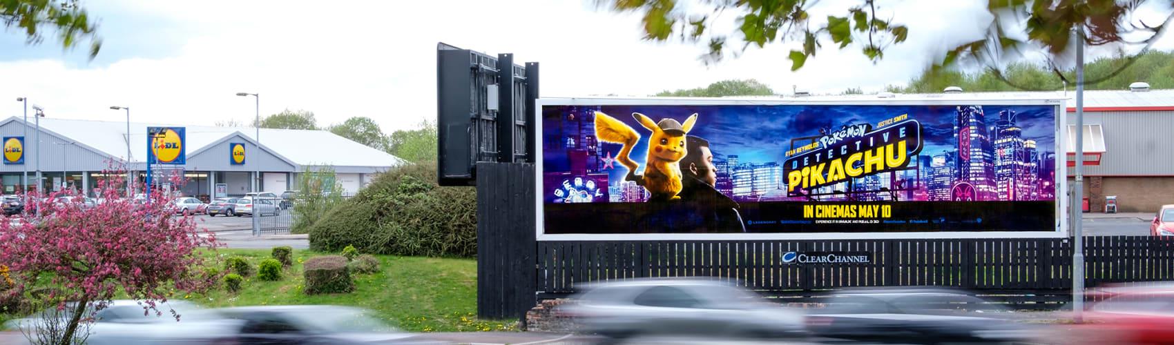 96-sheet billboard by a busy road