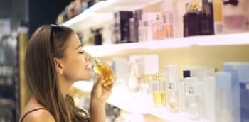 Smelling perfume from Duty Free display