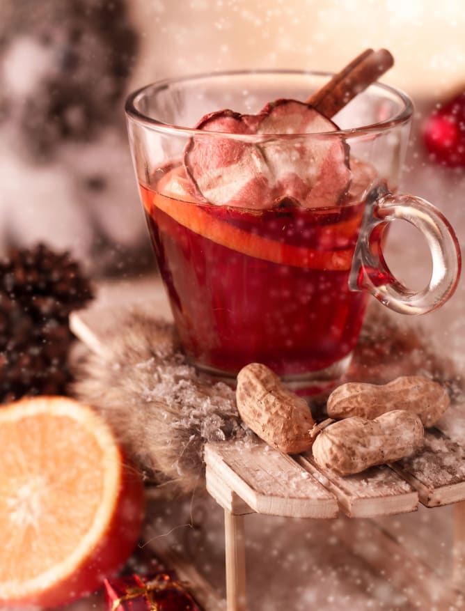 Festive Glühwein (mulled wine) with spiced fruit and cinnamon