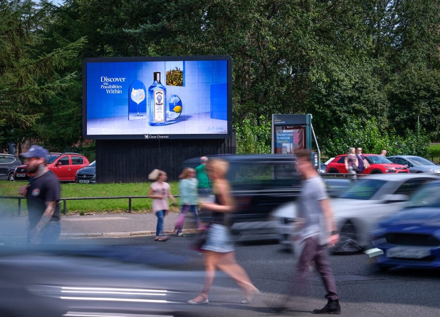 Digital billboard with lots of pedestrians