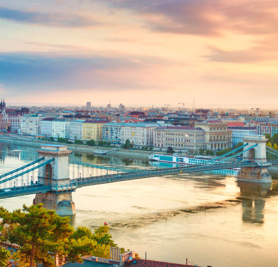 The Danube riverside in Budapest with Chain Bridge and river cruises