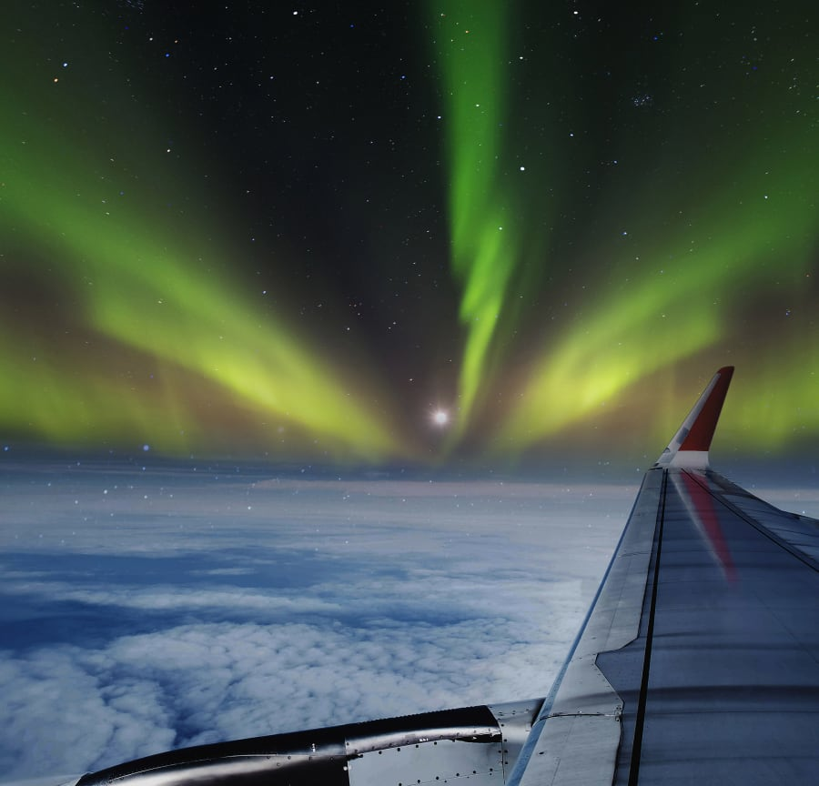 The Northern Lights from a plane window