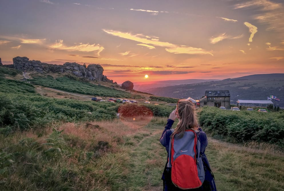 Nature and Mental health. A woman watching the sunset