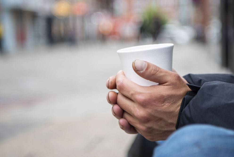 A person holding a paper cup