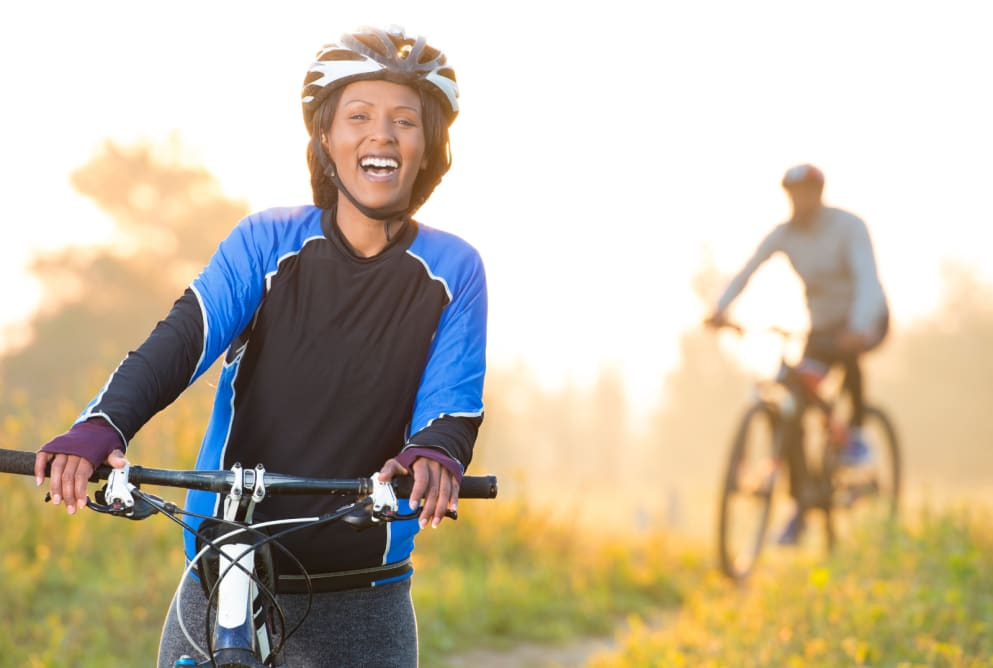 A woman on a bike is laughing