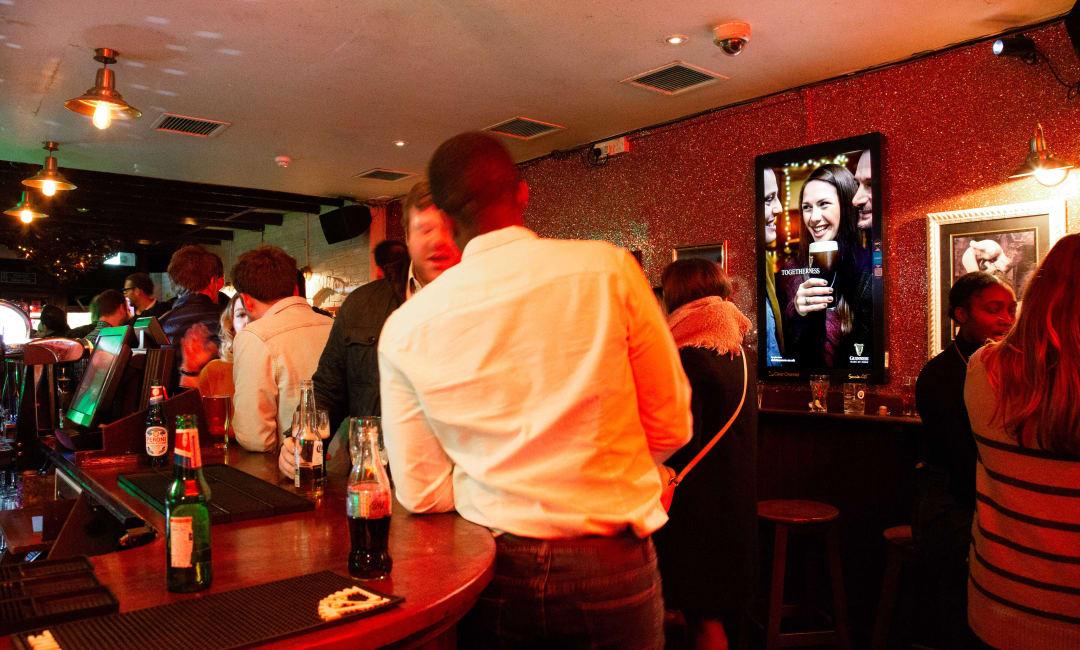 Socialite advertising screen in a bar