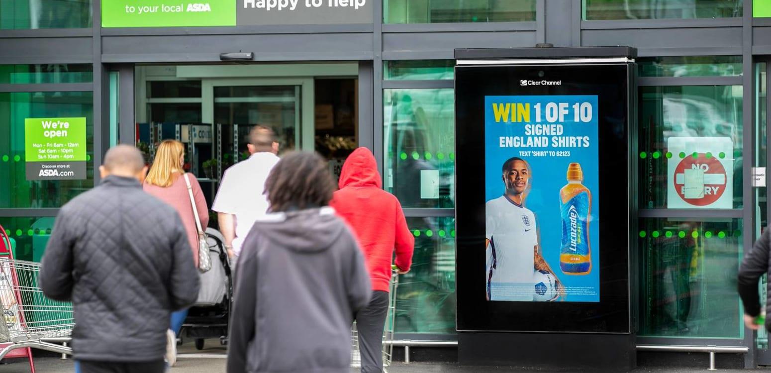 Digital poster outside supermarket