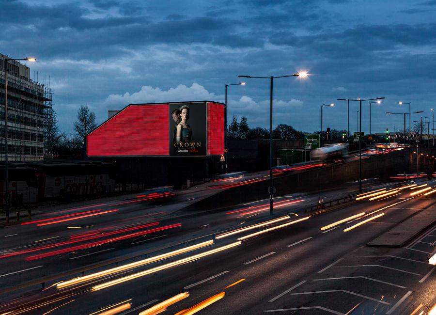 Large digital screen with lighting surround next to motorway