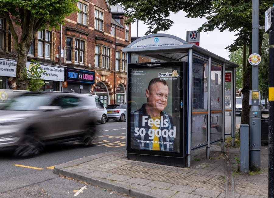 Adshel bus shelter photo featuring Pension Bee poster campaign