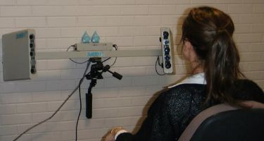 A women getting her face scanned with a 3D camera .