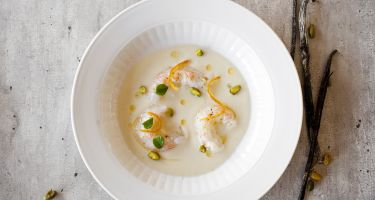 Cauliflower velouté with langoustine, orange zest and pistachio . Credit: Foodpairing