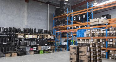 The Machine can turn the contents of this warehouse… . Credit: Aeontech