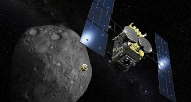Artist's impression of the Hayabusa2 mission approaching the asteroid Ryugu . Credit: Akihiro Ikeshita