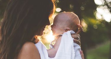 … the effect is more pronounced in mothers, suggestingit occurs to provide an emotional link between mother and child .