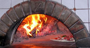 …and understand the secrets behind their skilled hands and wood-burning brick ovens .