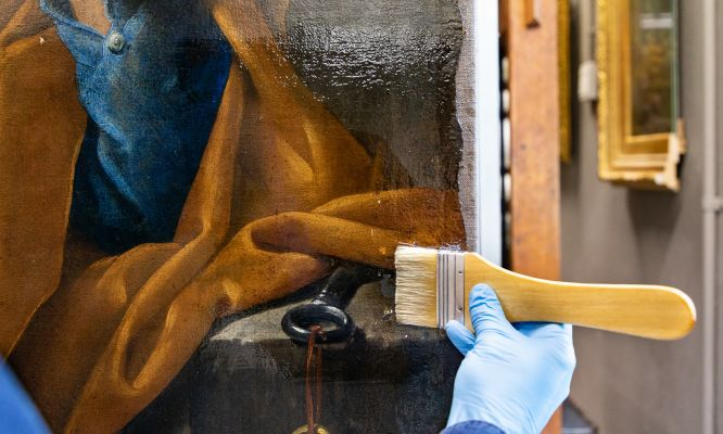 The MS3 Resin being applied to a painting at the National Gallery of Victoria.