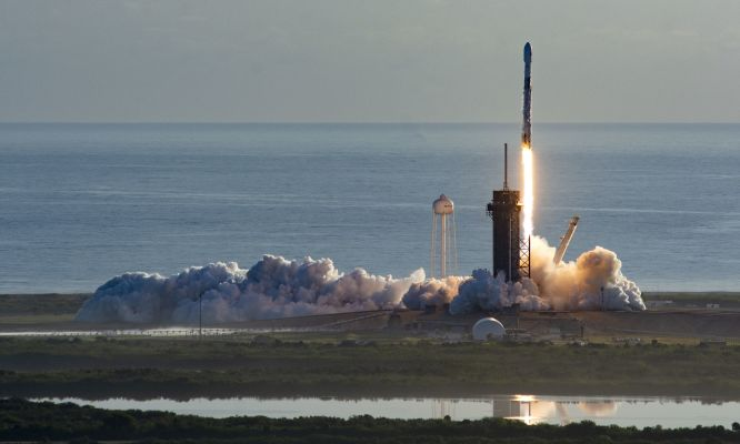 A SpaceX Falcon 9 rocket lifts off with a payload of Starlink broadband satellites.