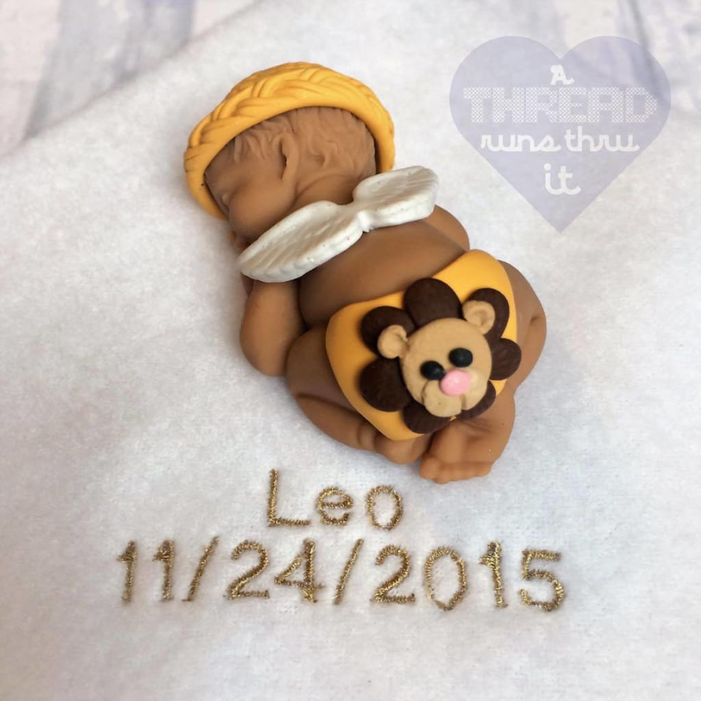 Angel baby keepsake with lion on diaper #athredrunsthruit