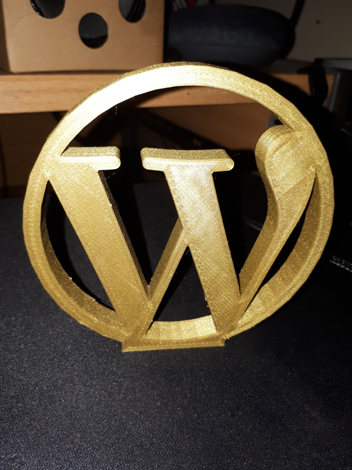 WordPress logo 3d printed in Gold filament